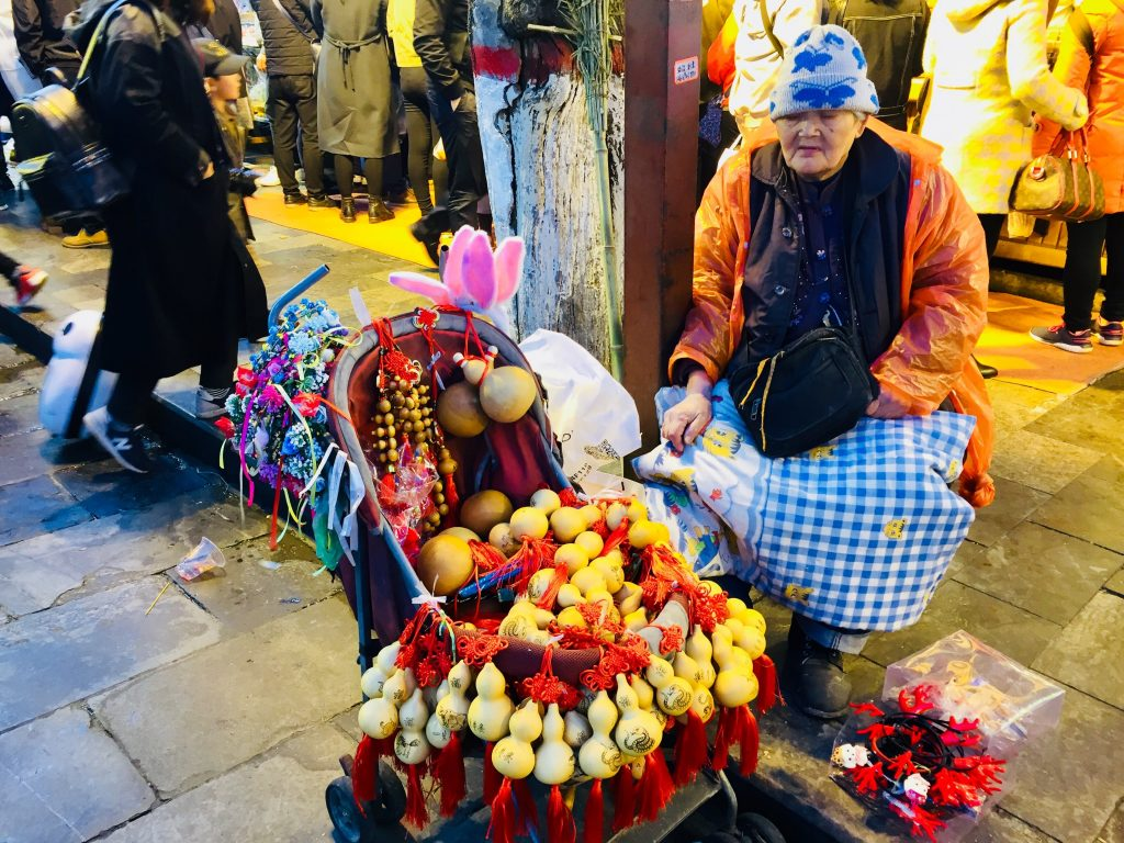 Lady selling gourds
